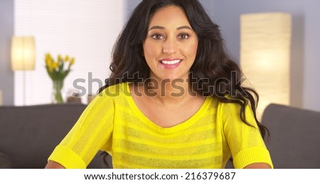 Casual Mexican woman smiling to camera - stock photo
