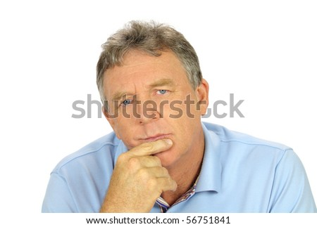Casual middle aged man with hand on chin with a concerned look. - stock photo