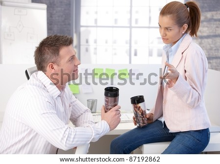 Casual office workers having coffee break in office chatting, drinking coffee.  .? - stock photo