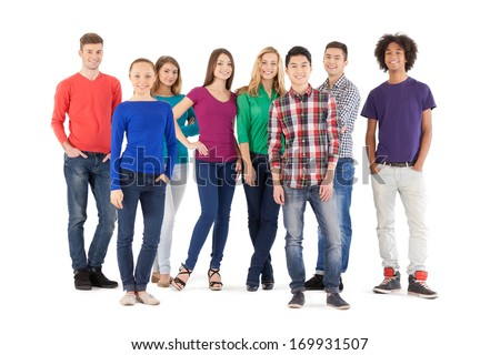 Casual people. Full length of cheerful young people smiling at camera while standing isolated on white - stock photo