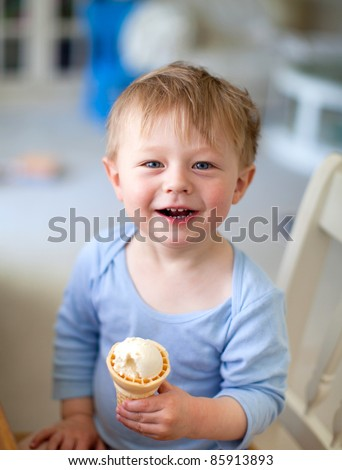 Casual portrait of a cute toddler with an ice cream cone - stock photo