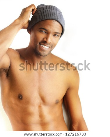 Casual portrait of a great looking young male model smiling against white background with copy space - stock photo