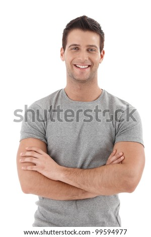 Casual portrait of happy university student guy standing with arms folded, laughing. - stock photo