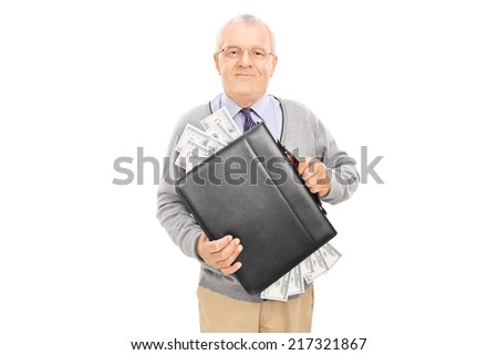 Casual senior holding a briefcase full of cash isolated on white background - stock photo
