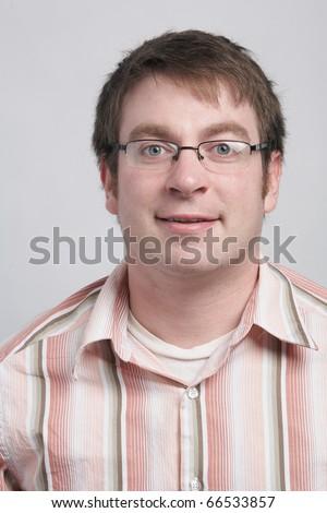 Casual smiling happy young man studio headshot - stock photo