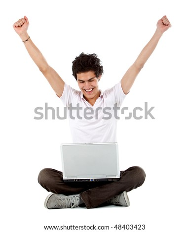 Casual successful man celebrating on a laptop computer over a white background - stock photo