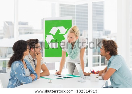 Casual team having meeting about eco policy in the bright office - stock photo