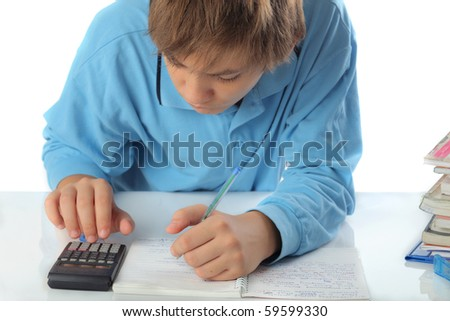 casual teenager doing math on calculator - stock photo