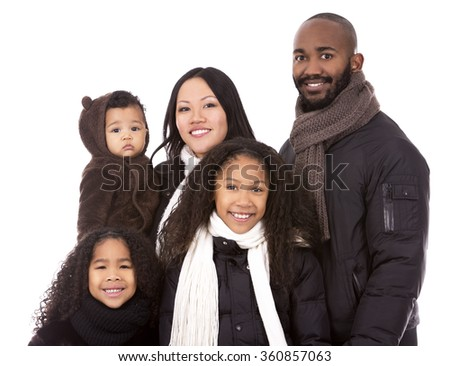 casual winter mixed family on white isolated background - stock photo