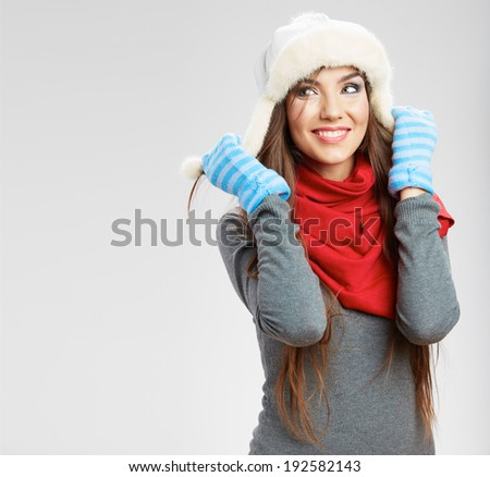 Casual winter style yong smiling woman portrait. Girl studio isolated, posing white background. Female young model. - stock photo