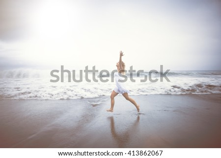 Casual Woman Celebrating Life by the Beach  - stock photo