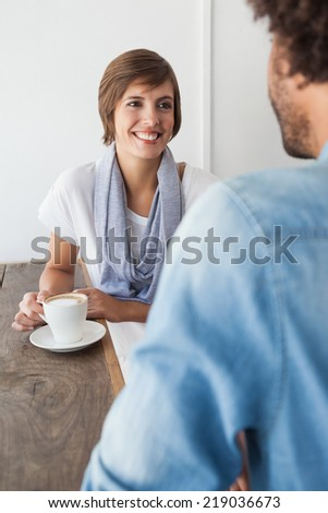 Casual woman having a coffee with friend at the coffee shop - stock photo