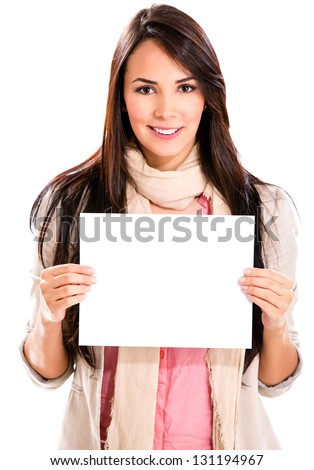 Casual woman holding a banner ad - isolated over white - stock photo