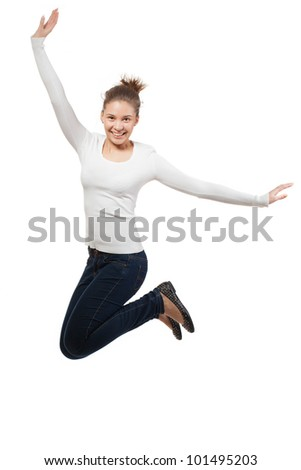 Casual woman jumping in joy ? isolated over a white background - stock photo