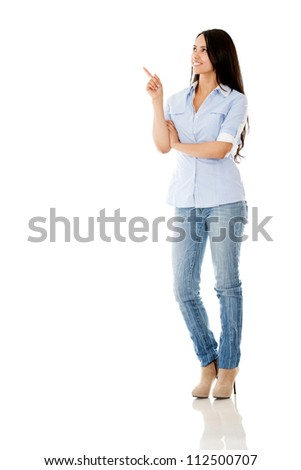 Casual woman pointing with her finger - isolated over a white background - stock photo