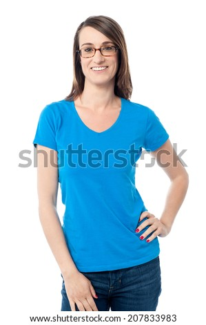 Casual woman posing with hands on her waist - stock photo