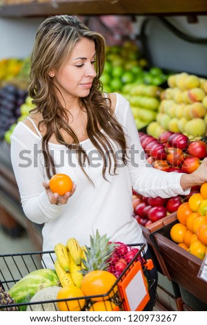 Casual woman shopping for groceries at the market - stock photo