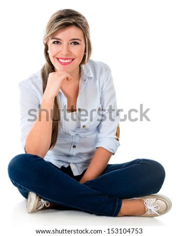 Casual woman sitting on the floor smiling - isolated over white  - stock photo