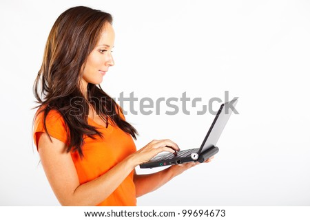 casual woman using laptop computer - stock photo