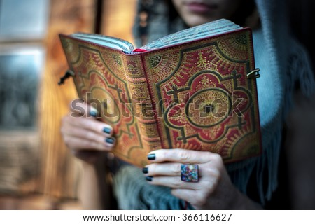 Casual woman with a book on her hands - stock photo