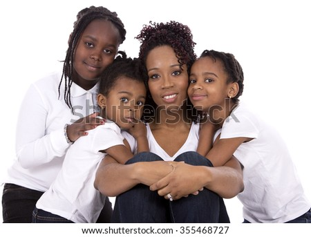 casual young black family on white isolated background - stock photo