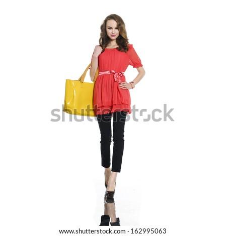 casual young fashion holding yellow bag walking - stock photo