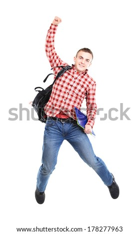 casual young man jumping on white  - stock photo
