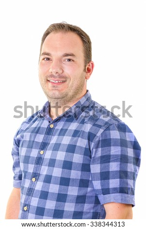 Casual young man looking at camera  and smiling on white background.  - stock photo