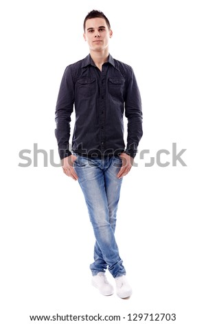 Casual young man standing with his legs crossed, in full length pose, isolated on white background - stock photo