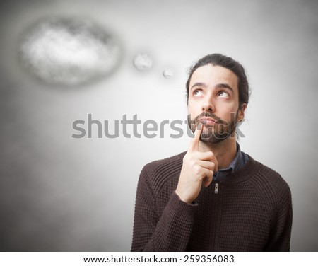 Casual young man thinking with a cloud  - stock photo