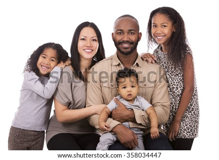 casual young mixed family on white isolated background - stock photo
