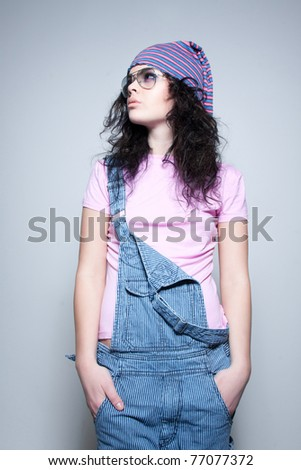 Casual young model looking to the side - stock photo