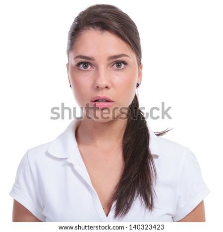 casual young woman looking baffled at the camera. isolated on white background - stock photo