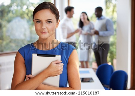 Casually Dressed Businesswoman At Meeting In Boardroom - stock photo