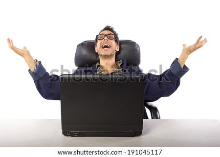 casually dressed man with glasses browsing the internet - stock photo