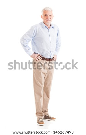 Casually dressed senior man posing with his arms akimbo. - stock photo
