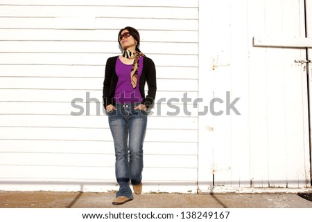 Casually leans on building. - stock photo