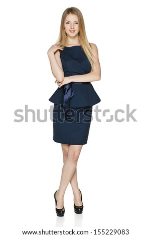 Casually standing carefree businesswoman in full length against white background - stock photo
