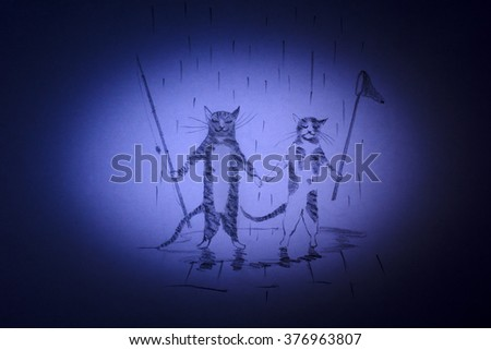 Cat and kitten are going to go fishing with a fishing rod and a net - stock photo
