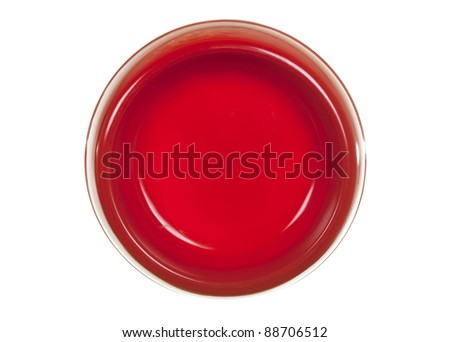Cat/dog feeding red bowl, view from above; isolated on white background - stock photo