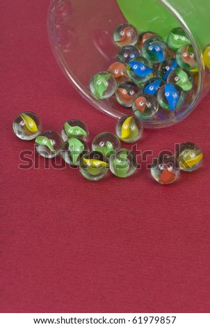 Cat Eye Marble Childrens Toy Background - stock photo