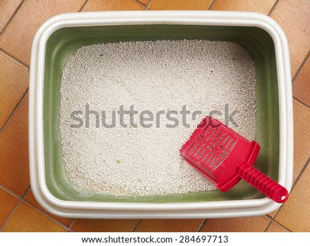 Cat litter, in the box, made of little stones of clay.    - stock photo