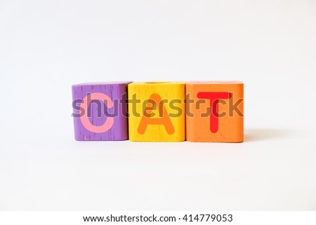 CAT word written on wood blocks, white background with copyspace - stock photo