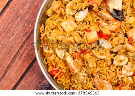 Catalan Fideua, a traditional seafood dish from north east Spain similar to paella but made with short lengths of pasta instead of rice. - stock photo