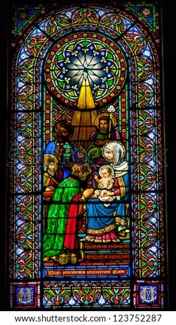CATALONIA, SPAIN--OCTOBER 18, 2012 Stained glass Magi three kings baby Jesus Mary in Monestir Monastery of Montserrat, Barcelona, Catalonia, Spain on October 18, 2012.  Placa de Santa Maria. - stock photo