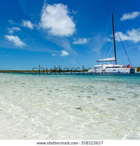 Catamaran at the beach - stock photo