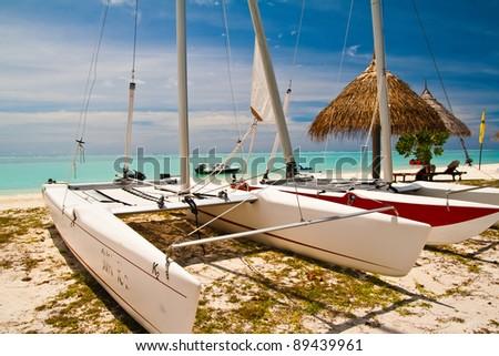 Catamaran at the tropical beach, Maldives - stock photo