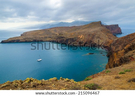 Catamaran boat in ocean bay on coast of Madeira island, Portugal - stock photo