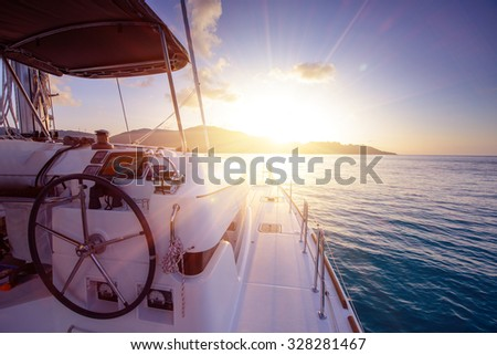 Catamaran close exterior at sunset - stock photo