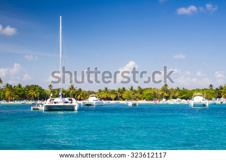 Catamarans landing in the harbor of tropical beach in Bayahibe, Dominican Republic - stock photo